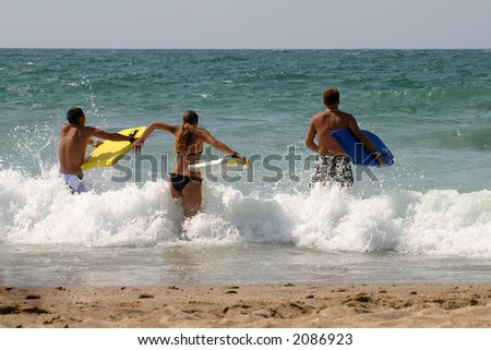 Beach fun for three guy in the waves