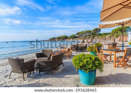 Beach furniture on sandy Palombaggia beach, Corsica island, France - stock photo