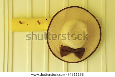 Beach hat hang on the wood wall background - stock photo