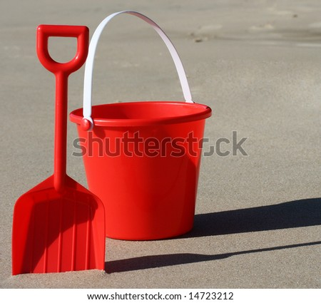 Beach holiday bucket and spade. - stock photo