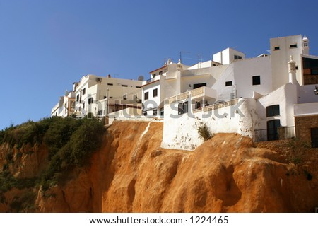 beach homes on a cliff in Albufeira, Algarve, Portugal - stock photo