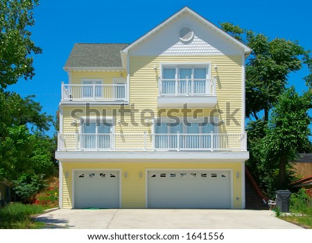 Beach House in Summer -Three story summer cottage at the beach. - stock photo