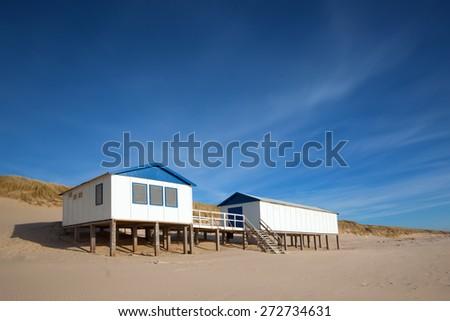 Beach house on a blue sky - stock photo