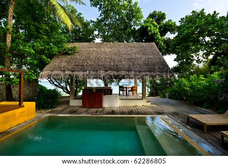 beach house with private swimming pool - stock photo
