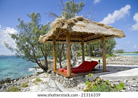 Beach hut on beautiful small and rocky tropical island. - stock photo