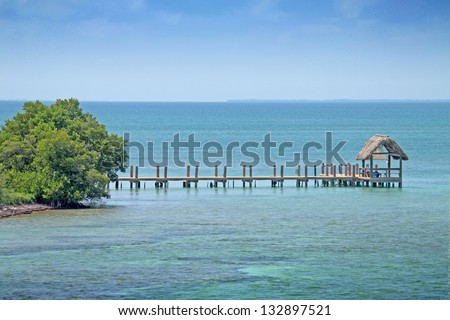 beach hut on the reef - stock photo