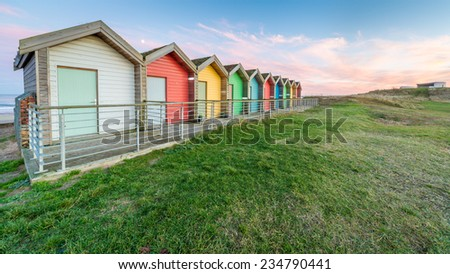 Beach huts at dusk in Northumberland - stock photo