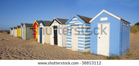Beach huts at southwold beach in summer - stock photo