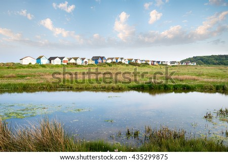 Beach huts on Mudeford Spit between Hengistbury head and Mudeford at Christchurch in Dorset - stock photo