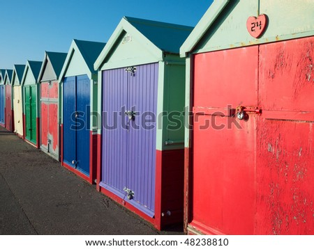 Beach huts on the seafront in Brighton - stock photo