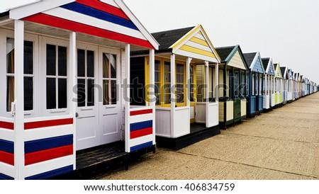 Beach Huts; row of traditional English seaside beach huts - stock photo