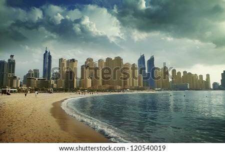 Beach in Dubai in cloudy day. Panoramic view. - stock photo
