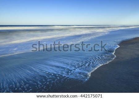 Beach in Late Afternoon Sun - Long Exposure - stock photo