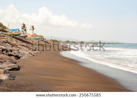 Beach in Lovina with typical indonesian boats called jukung, Bali, Indonesia - stock photo