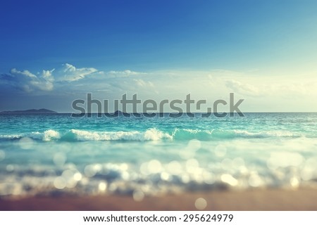 beach in sunset time, tilt shift soft effect  - stock photo