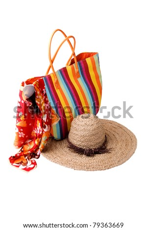 Beach items: colorful striped bag, bright kerchief, sunglasses and straw hat
