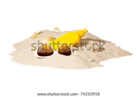 beach items on a sunny pile of sand - stock photo