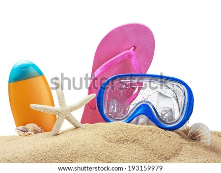 Beach items on sand isolated on white background - stock photo
