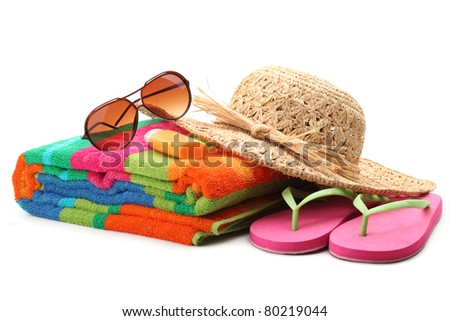 Beach items with straw hat,towel,flip flops and sunglasses.Isolated on white background. - stock photo