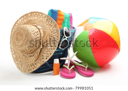 Beach items with straw hat,towel,flip flops,sunblock,beach ball and sunglasses. - stock photo