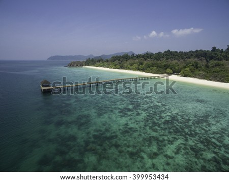 Beach, jetty and turquoise water view from above on an island of Mergui Archipelago in Myanmar/Burma