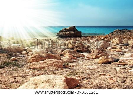 Beach landscape with rocks - stock photo