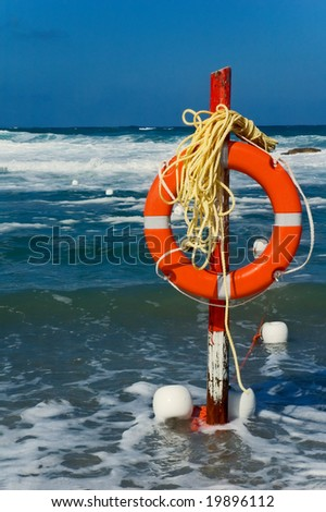 Beach life saver with rough sea in the background - stock photo