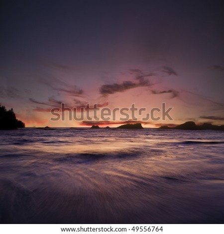 Beach located on the Oregon Coast. Sunset on a beach with a long exposure to capture the movement of the waves. Dusk. - stock photo