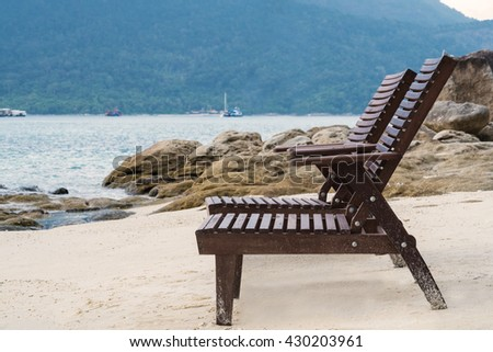 Beach lounge chairs on the beach in the morning. vacation time.beach holiday.beach travel.summer time - stock photo
