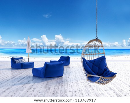 Beach lounge deck with sunbeds umbrella and hanging chair with sea view - stock photo