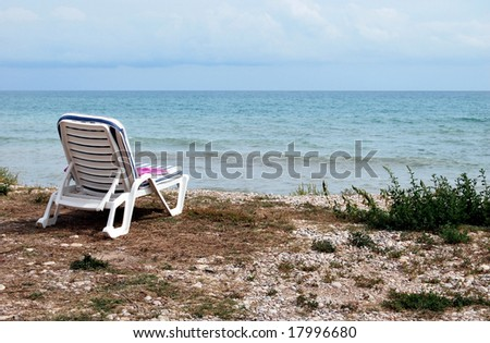 Beach Lounge in a empty beach - stock photo