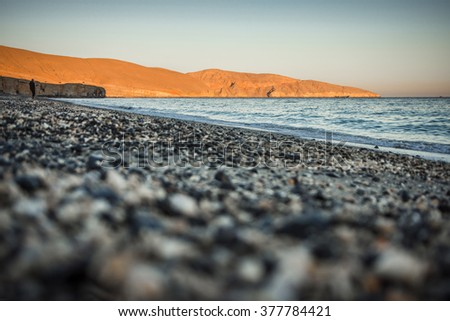 Beach near Khasab town, Musandam peninsula, Oman, Arabia (shallow depth od field image) - stock photo