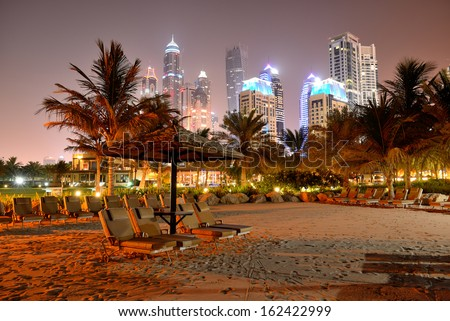 Beach night illumination of the luxury hotel, Dubai, UAE - stock photo