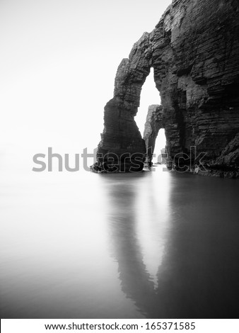 Beach of Las Catedrales or As Catedrais, Ribadeo, Galicia, Spain. The photo is taken in black and white - stock photo