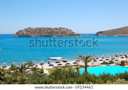 Beach of luxury hotel  with a view on Spinalonga Island, Crete, Greece