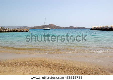 Beach of luxury hotel with yacht view, Crete, Greece