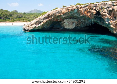 Beach of Mediterranean Sea and the grotto on Majorca island, Spain