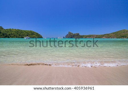 Beach of Phi Phi Island in Andaman Sea with Blue Sky at Krabi, Thailand - stock photo