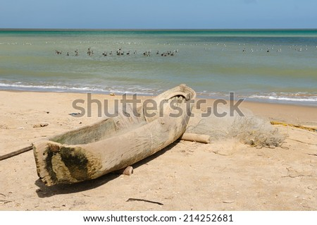 Beach of the Caribbean sea in Colombia in the vicinity of the Riohacha town. Traditional fishing boat built of the one-piece tree.