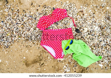 Beach outfit. Summer beach accessories set, sunglasses and beach towel. Beach holiday concept, , view from above, top view