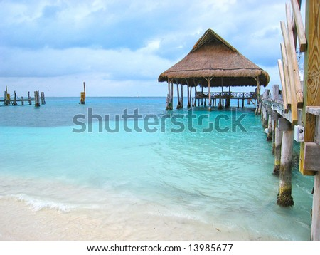 beach pier and palapa hut on dock - stock photo