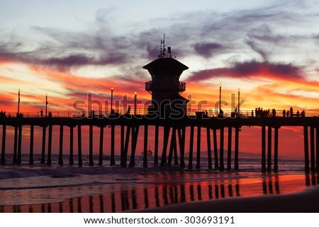 Beach Pier at Sunset in California                                - stock photo