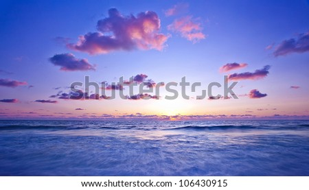 Beach, pink light sunset, beautiful calm landscape of waterscape, peaceful Mediterranean sea panoramic view, zen blur motion on tide waves, deep ocean bay, summer scenic nature, vacation and travel - stock photo