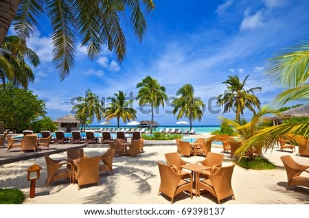 Beach pool in a tropical hotel - stock photo