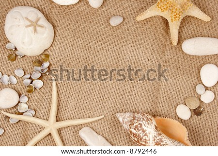 Beach postcard with sea shell and star fish on a burlap