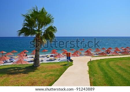 Beach promenade in Kolymbia Bay, Rhodes island - stock photo