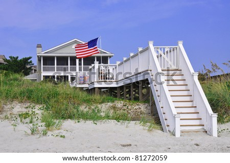Beach rental on a summer day, with American Flag blowing in the wind