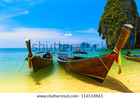 Beach resort exotic ocean journey. Scenery Thailand view with thai boats on sea coast  - stock photo