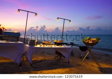 Beach restaurant at sunset - stock photo