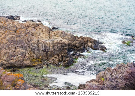 Beach rock rocks sea sky landscape - stock photo